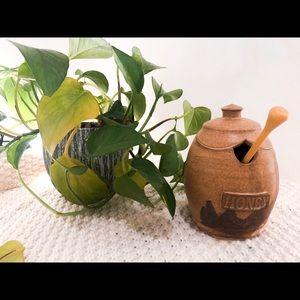 Brown paint stripe ceramic honey pot with comb.